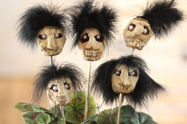 Dried apple shrunken heads make the perfect gruesome table centerpiece.
