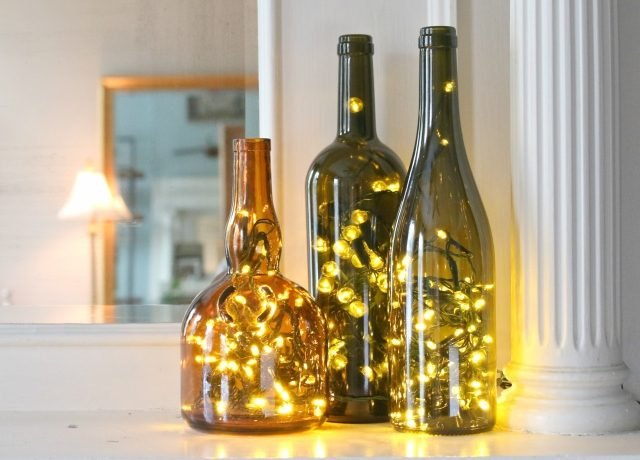 Christmas lights in empty wine bottles create cheerful holiday luminaries.