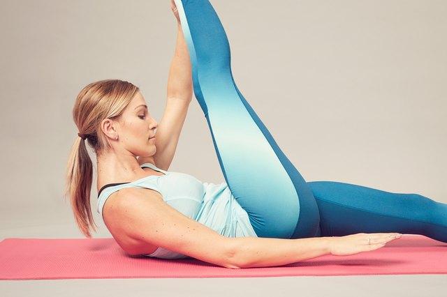 Pretty woman doing pilates