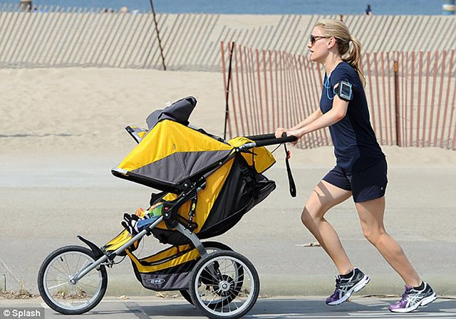 Anna Paquin running while pushing a stroller
