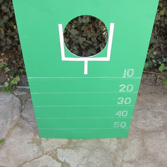 Green painted goal post sign with scoreboard