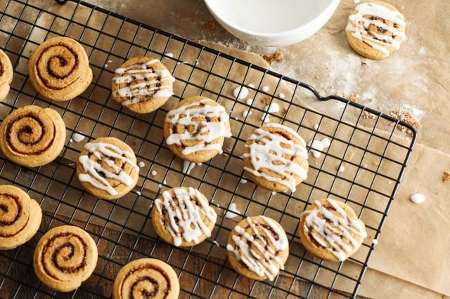 Baked sweet potato cinnamon roll cookies iced with frosting.