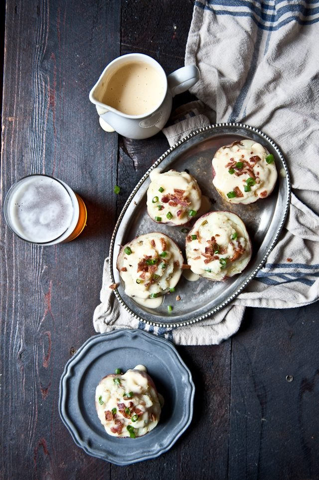 Twice-baked beer cheese red potatoes topped with green onions and bacon.