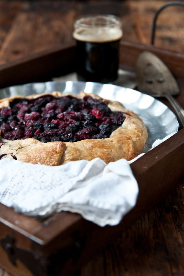 Chocolate stout and mixed berry galette in a silver pie plate.