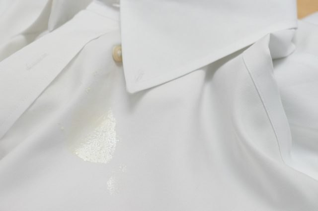 Butter stain on a white shirt