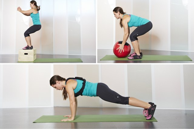 Woman adding equipment to her burpee variations
