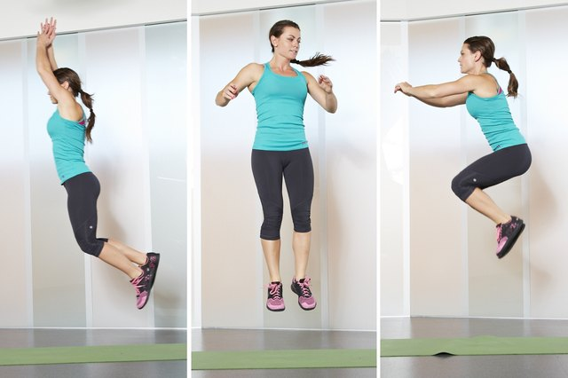 Woman doing jump variations while doing different burpees