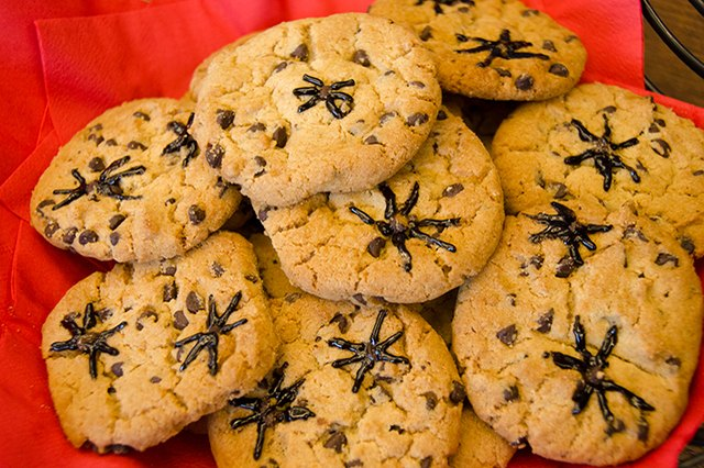 Store-bought cookies drawn on with black icing.