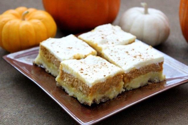 Four pumpkin crisp bars on a square plate