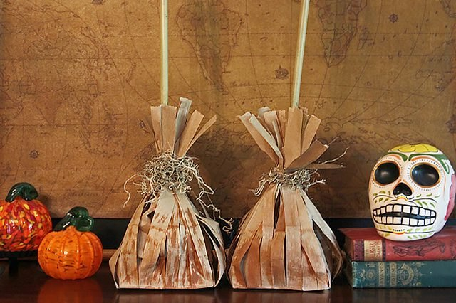 Kids will love helping create and fill these frightening witch's broom treat bags.