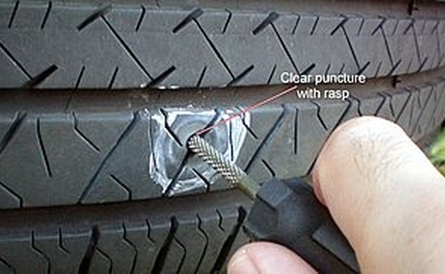 Clean the puncture by running the rasp in an out of tire.