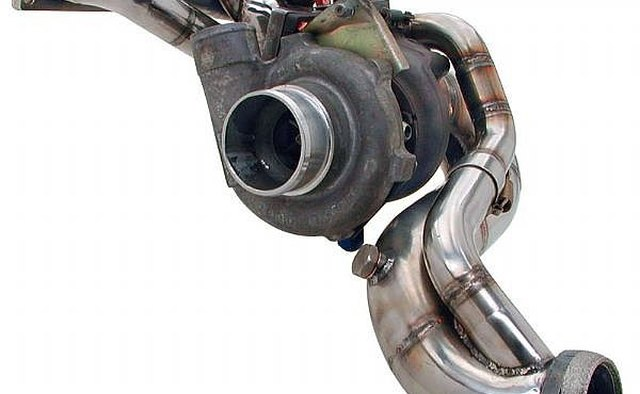 Turbo header with turbocharger attached