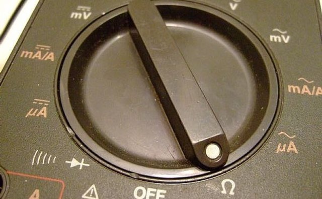 Set the dial for Ohm test