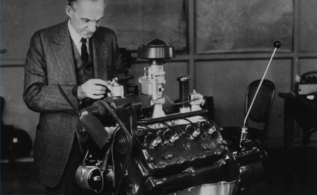 Ford founder Henry Ford tinkers with his version of the V8 engine.