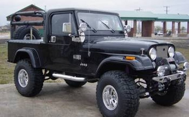 A winch, sidesteps and cargo bed rollbar are aftermarket equipment accessories.