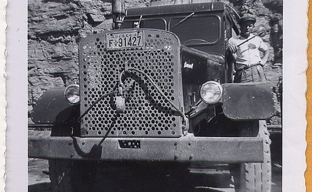 Driver with His Early 1950s Mack Tractor-Trailer Rig.