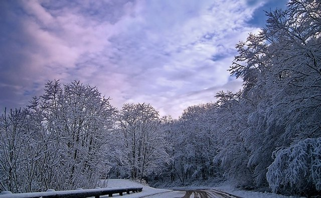 A road covered with light snow