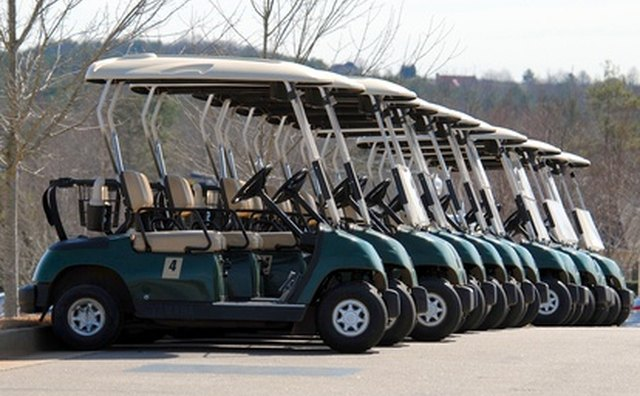One color scheme of the 2003 Club Car included green with beige trim and canopy top.