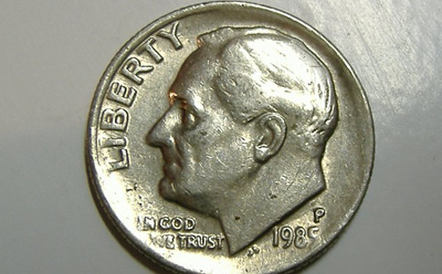 A dime can be used to pry open some remotes.