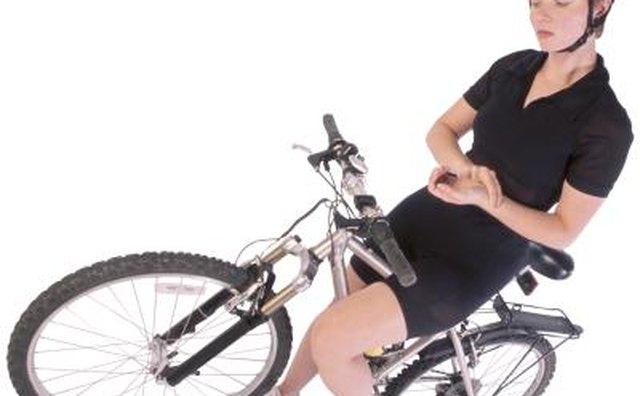 Woman taking her pulse on bike