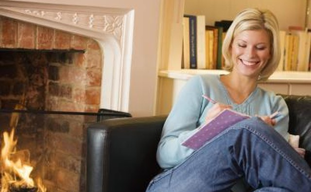 Woman sitting next to fireplace