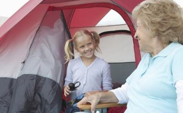 Little girl smiling outside tent