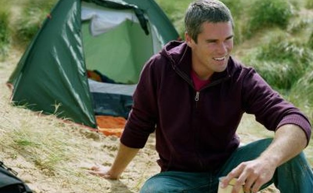 Man relaxing outside tent