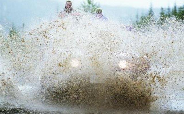 ATV driving through mud
