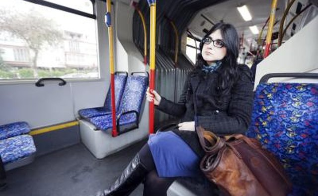 woman sitting in bi-articulate bus