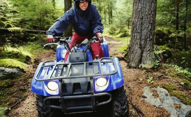 Man driving ATV in woods