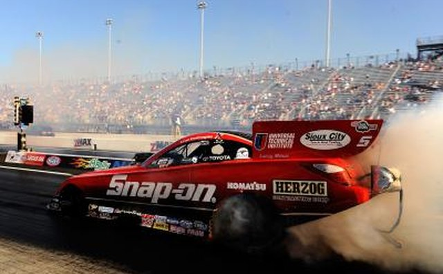 Funny cars have similar engine output to the Top Fuel dragster, but have full bodies.
