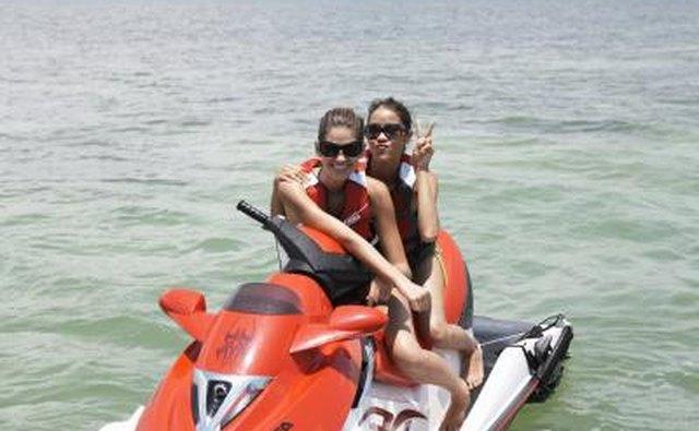 girl friends on jet ski in Tampa Bay