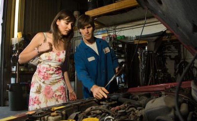 Car mechanic and customer