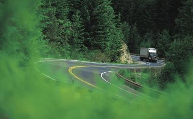 Semi truck winding through mountainous roads