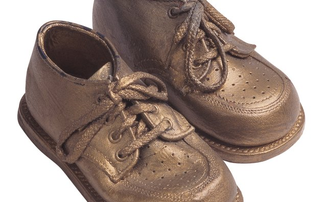 Bronzed shoes can be displayed on a dresser, shelf or desk.