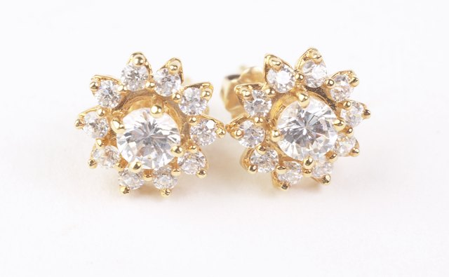 A simple pair of diamond studs accent your silver dress without pushing the sparkle over the top.