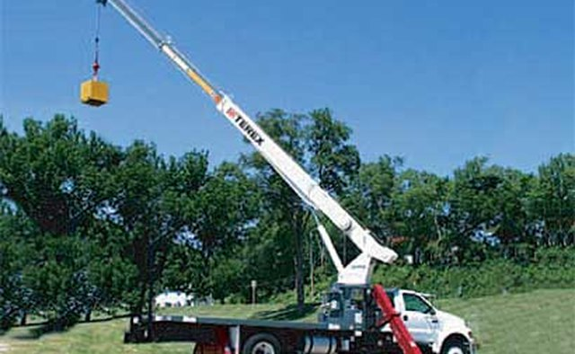 This Stinger BT 3063 with stabilizers and outriggers has a 113-foot reach.