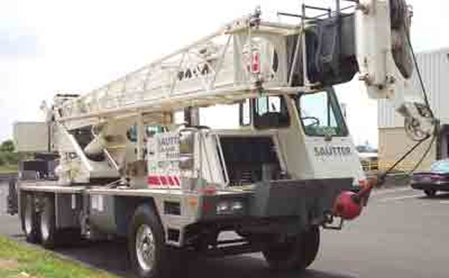 A 30-ton boom truck with sidemounted cab.