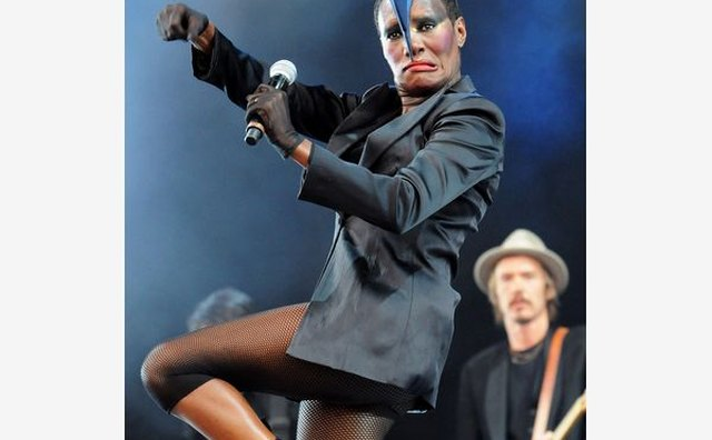 Grace Jones' fierce electric blue headpiece shows her steadfast style at a 2011 performance.