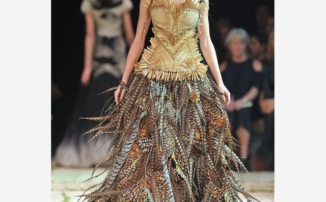 A model walks down the runway in the Alexander McQueen Spring/Summer 2011 show in Paris.