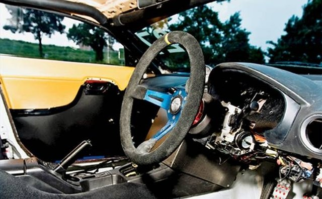 Stripped down right-hand drive interior of the 2000 model.
