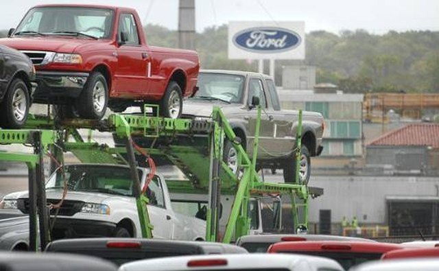 Ford Rangers are loaded onto a carrier at the St. Paul plant for delivery to dealers.