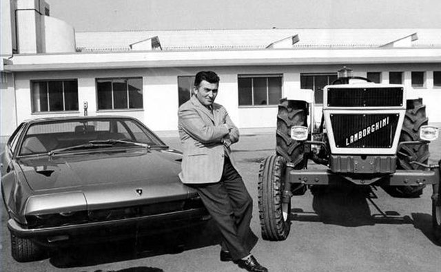 Ferruccio Lamborghini with his sports car and tractor products.