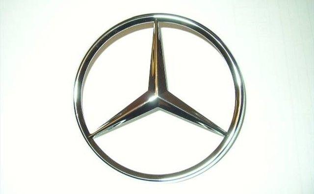 History of the mercedes emblem it still runs your for Mercedes benz star emblem