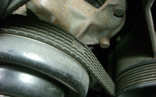 Replace a worn out serpentine belt. [FixEuro.com/Picasaweb.google.com].