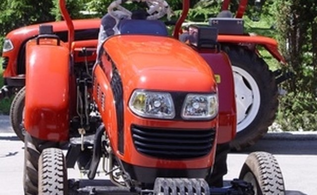 The orange Kubota tractors stand out in a world of John Deere green.