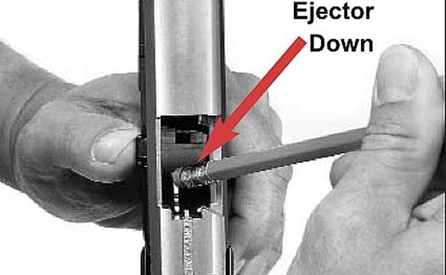 Push the Ejector Lever in its Locked Forward Position