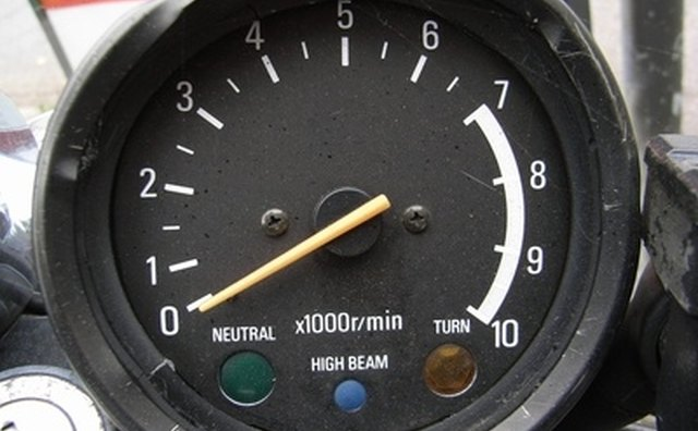 A motorcycle tachometer with a neutral indicator.