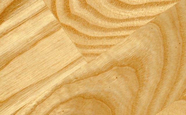 Examine wood subfloor for damage.