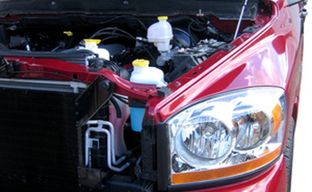 Typical vehicle battery location is under the hood in the engine compartment.